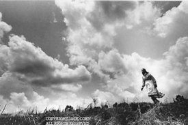 Choctaws, Woman on  mound, clouds