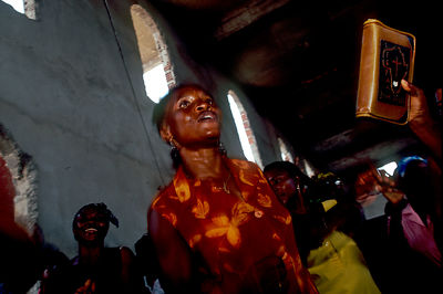Angola - Luanda - A woman works herself to a religious frenzy