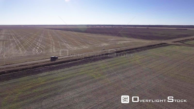 Drone Footage SUV Vehicle Driving on a Country Dirt Road Rural Saskatchewan Canada