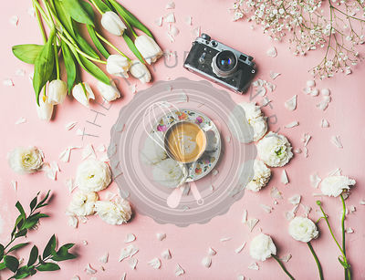 Spring layout with coffee, camera and white flowers