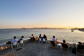 Cafes at the Ribeira das Naus esplanade, along the Tagus river. Lisbon, Portugal