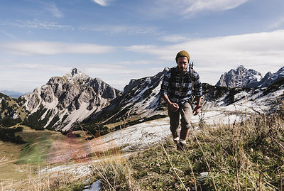 Austria, Tyrol, young man hiking in the mountains