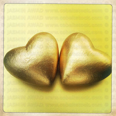 Two gold hearts close up..Cologne, Germany