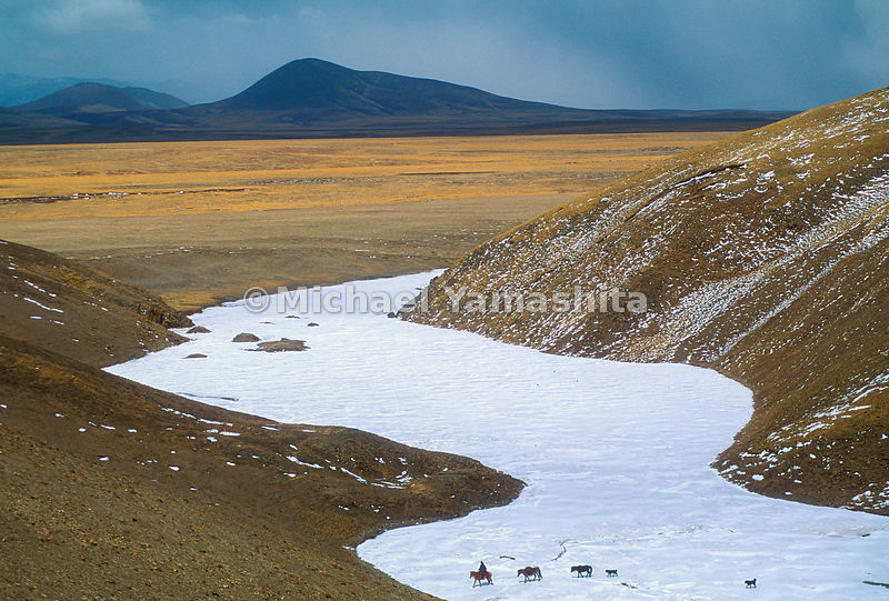The place the Tibetans call the sacred source of the Mekong is a frozen river bed at an altitude of 17,000 feet on the Tibetan Plateau. In search of a campsite, a guide crosses the three feet of ice under which the westernmost headwaters of the Mekong trickle.