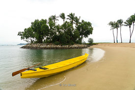 A boat at the Tanjong beach in Sentosa island. Singapore.