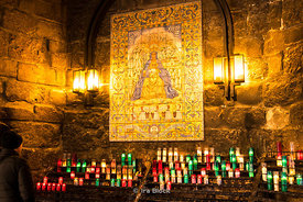 Candles inside the basilica Santa Maria de Montserrat on the Montserrat rocky range in Barcelona, Spain