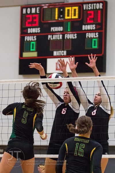 Linn-Mar's Megan Allmandinger (6) and Ashley Jones (8) go up to block versus Dubuque Hempstead's Heather Splinter (9) at the 2012 Linn-Mar Varsity Volleyball Tourney Saturday, September 8, 2012. (Justin Torner/Freelance)
