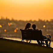 Young couple on a park bench in Observatory Park, Sydney, New South Wales, Australia