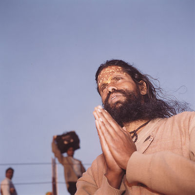 Pilgrim making devotions at the Kumbh Mela