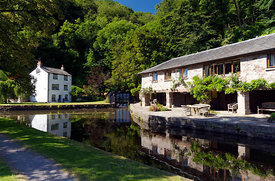 Llanfoist Wharf and boathouse used to store Iron from Hills Ironworks in Blaenavon, Abergavenny & BreconCanal near Abergavenny, Monmouthshire, Wales.