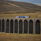Train passing over Ribblehead viaduct, Yorkshire Dales National Park, England, United Kingdom
