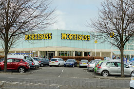 EDINBURGH, SCOTLAND – APRIL 16, 2016: Exterior view of the Morrisons supermarket and customer car park at the Gyle Centre located to the west of Edinburgh.
