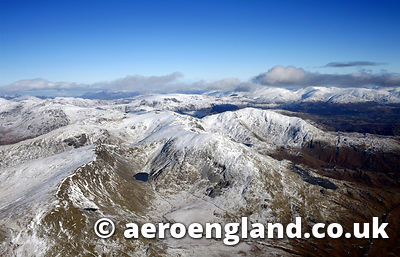 aerial photograph of the Old Man of Coniston in the Lake District Cumbria England UK taken in the .winter while covered in snow