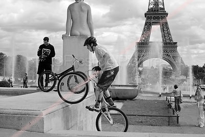 Stunt Cyclist Mounting a Plinth by the Palais de Chaillot in Black and White