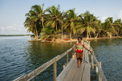 Woman on a walking bridge in the Volta estuary, Ada Foah, Ghana