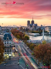 Top view of Paris city and Notre Dame cathedral at sunset