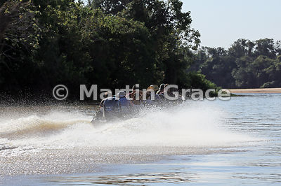 Jaguar sighted! The race is on! Tourist boat races off at top speed trying to be one of the early arrivals at a new sighting, River Cuiabá, North Pantanal, Mato Grosso, Brazil
