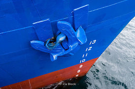 An anchor on the bow of a ship anchoring at a port in Lofoten Islands, Norway.