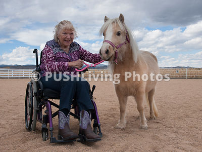 Mature woman in a wheelchair with her pony