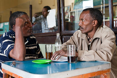 Ethiopia - Addis Ababa - Two customers talk in the Ras Makonnen coffee house