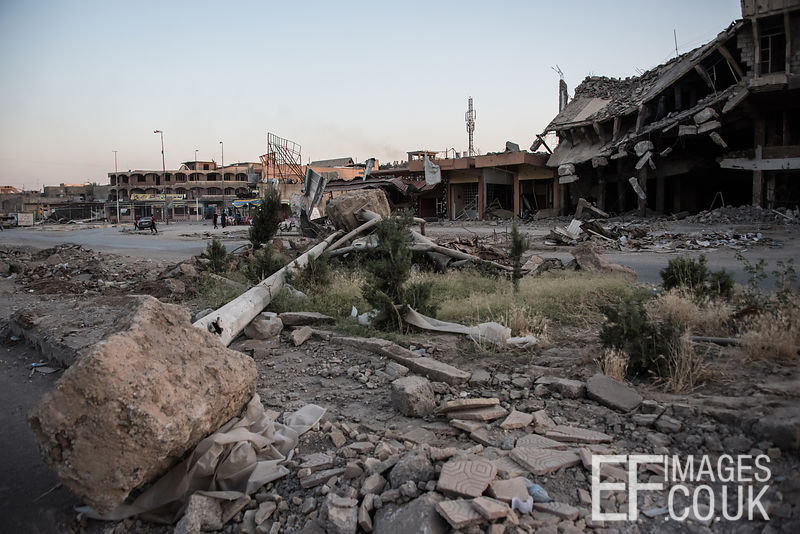 Prone lamposts lie flattened across the central reservation of the main road bisecting Kanisa District in West Mosul. Iraq, 4th June 2017