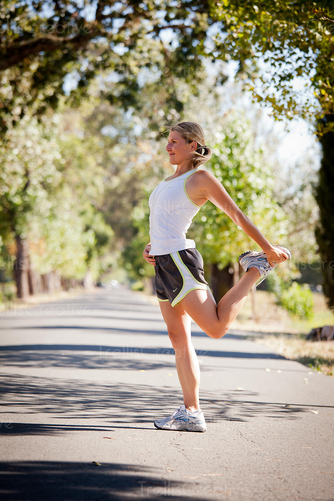 Young athletic woman stretches before running exercise