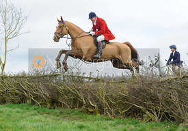 Ashley Bealby jumping a hedge above Klondike