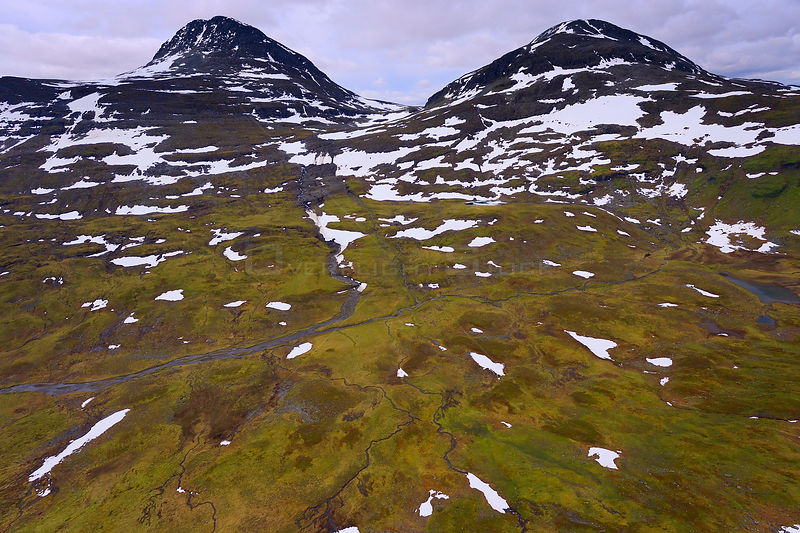 Aerial view of mountains with melting snow, the source of the Vietasatno River, Stora Sjofallet National Park, Greater Laponia Rewilding Area, Lapland, Norrbotten, Sweden, June 2013.