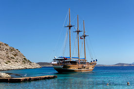 Three masted wooden sailing ship, Kania Beach, Chalki Island near Rhodes, Dodecanese Islands, Greece.