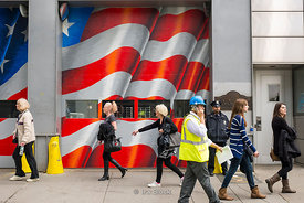 People walking on the street around National September 11 Memorial & Museum in New York.