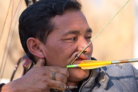 A man drawing a bow at an archery contest in Paro, Bhutan.