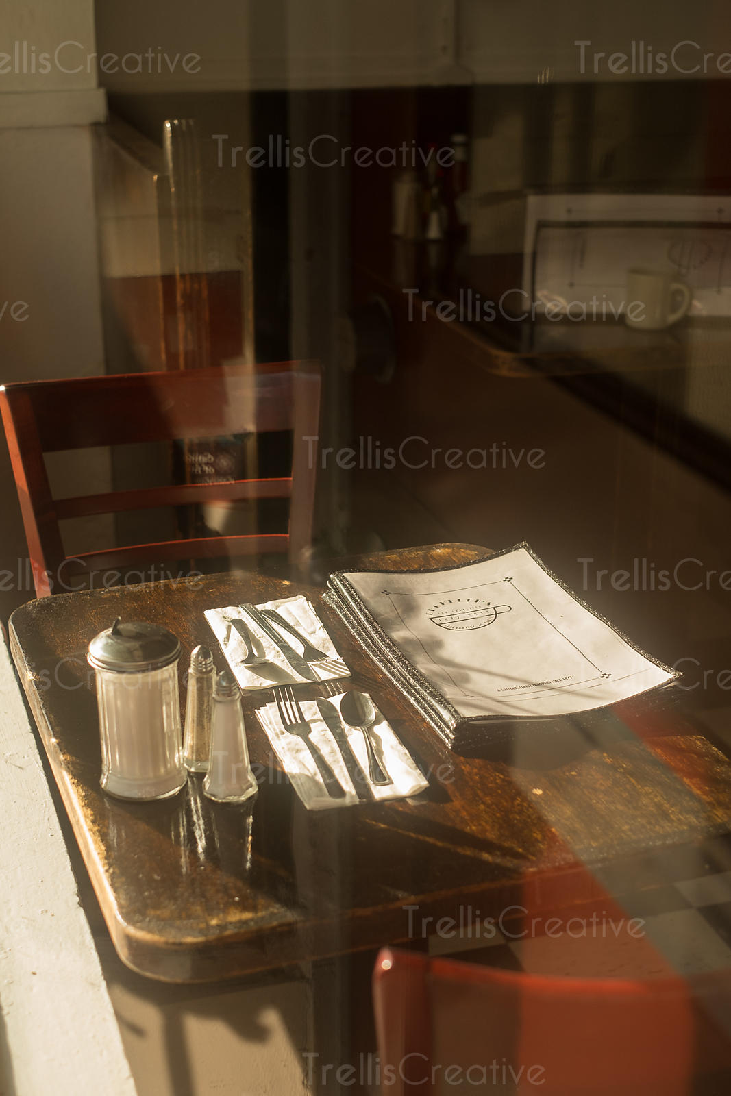 An old diner table with early morning sunlight