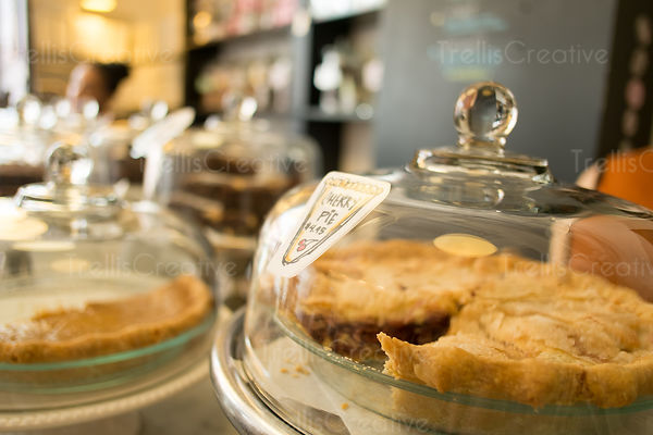 Fresh Cherry Pie covered with glass lid in bakery