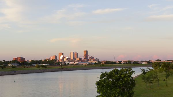 Wide Shot: Sunset Over Oklahoma City Skyline & Oklahoma River