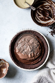 A chocolate pie base filled with melted chocolate