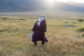 A nomadic Kazakh woman heads out to find her yaks for milking near Tolbo Lake in western Mongolia.