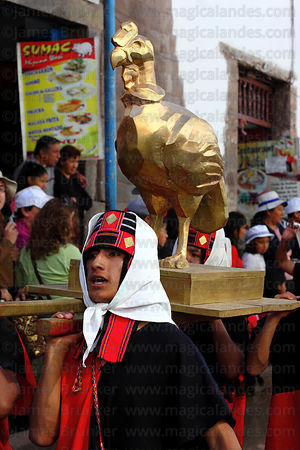 Bearers carry a golden condor during street processions for Inti Raymi festival, Cusco, Peru