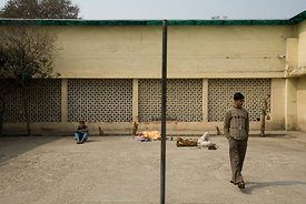 India - Delhi - Mentally ill people sit in the yard of a secure ward