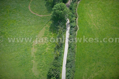 Aerial view of single track road though fields