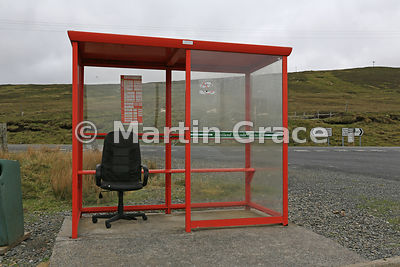 A chair that admittedly has seen better days providing a little bit of comfort while you wait for the bus, Yell, Shetland, Scotland