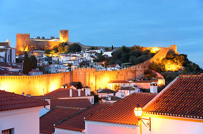 Óbidos at dusk, one of the most beautiful medieval villages in Portugal, taken to the moors in the 12th century.