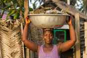 Woman carrying fish, Ada Foah, Ghana