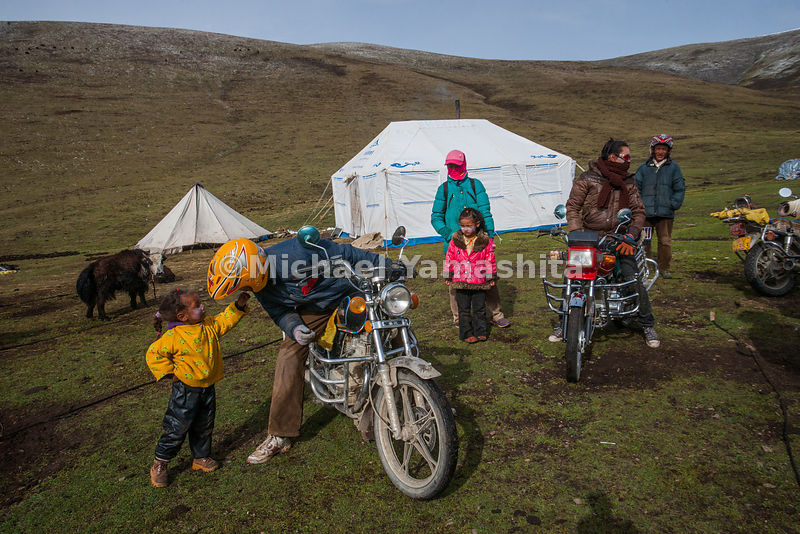 Motorcycles, purchased with the profits from Yartsa Gombu sales, are replacing horses for families like the Tuptens, who are camped near Hei Tu Shan Pass.