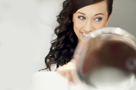 Beautiful brunette bride with blue eyes getting ready for wedding mirror