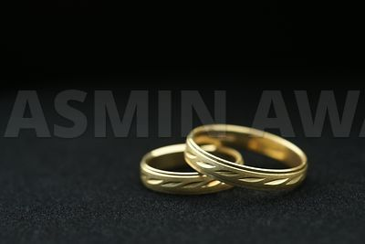 Gold wedding rings with black background
