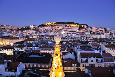 The historical centre and the São Jorge castle at dusk. Lisbon, Portugal