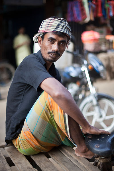 Bangladesh - Dhaka - A rickshaw puller at rest near the Chowk Bazaar