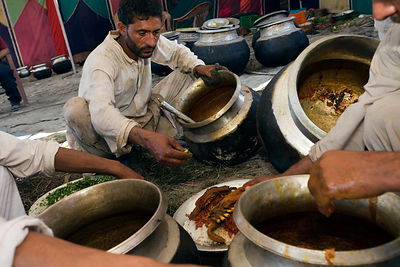 India - Srinagar - Wazas,  traditional Kashmiri cooks, serve Wazwan onto a Trami (plate) at a Wazwan feast