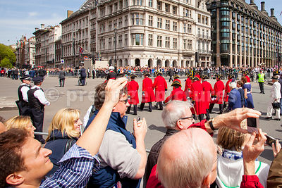 Spectators Photograph Chelsea Pensioners Marching in the Veteran's Parade