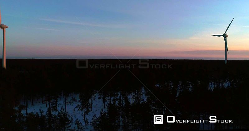 Wind Power Generators, 4k Aerial View Towards a Power Plant With Several Renewable Energy Propellers, Cold Sunny Winter Evening Dawn, Hanko, Uusimaa, Finland